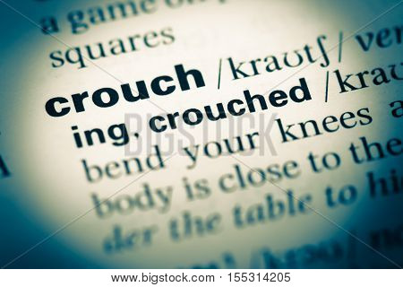 Close Up Of Old English Dictionary Page With Word Crouch