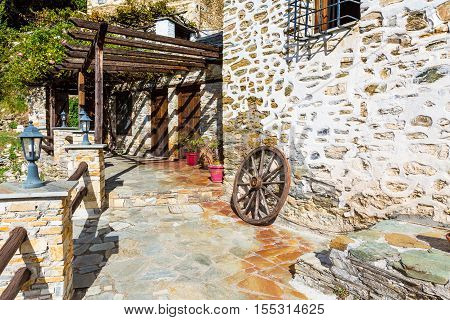 Street and typical greek rural house wall view at Makrinitsa village of Pelion, Greece