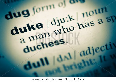 Close Up Of Old English Dictionary Page With Word Duke