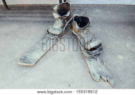 Irkutsk, Russia - May, 22 2016: Sculpture Of Old Torn Shoes And Broken Country Skis In Irkutsk Stree