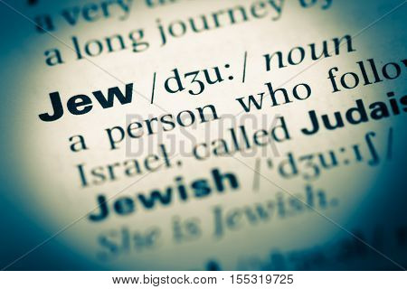 Close Up Of Old English Dictionary Page With Word Jew