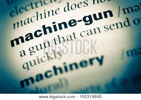 Close Up Of Old English Dictionary Page With Word Machine Gun