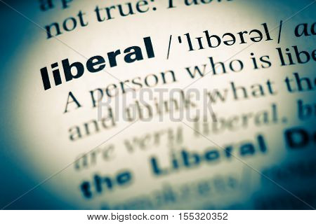 Close Up Of Old English Dictionary Page With Word Liberal
