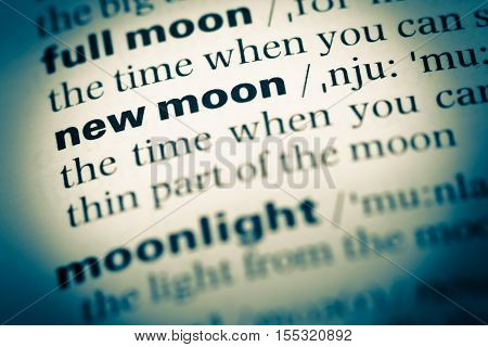 Close Up Of Old English Dictionary Page With Word New Moon