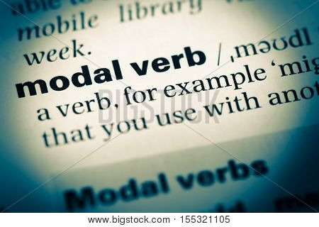 Close Up Of Old English Dictionary Page With Word Modal Verb