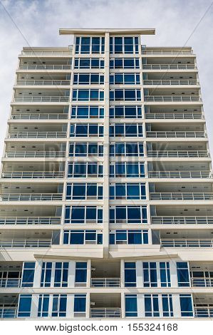 White Balconies on a Modern Condo Tower