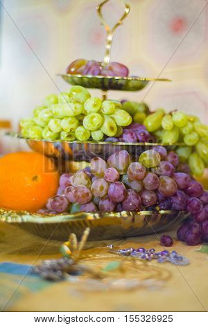 Fruits Lie On A Three-tiered Fruit Plate.