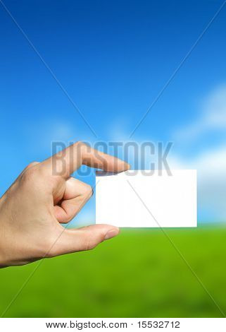 businessman holding up a blank card.