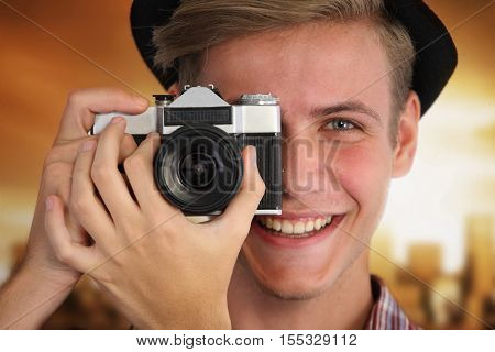 Portrait of a young hipster with vintage camera