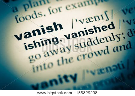 Close Up Of Old English Dictionary Page With Word Vanish