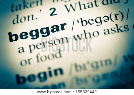 Close Up Of Old English Dictionary Page With Word Beggar