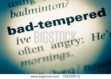 Close Up Of Old English Dictionary Page With Word Bad Tempered