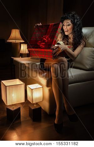 Beautiful girl with box of gift
