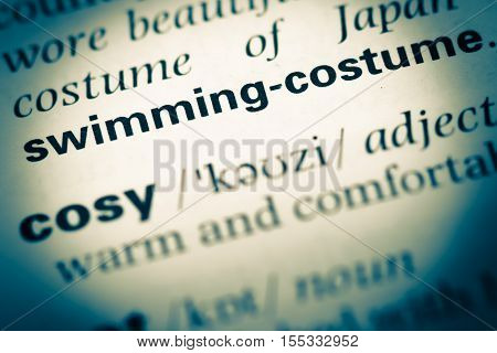 Close Up Of Old English Dictionary Page With Word Swimming Costume
