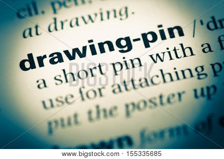 Close Up Of Old English Dictionary Page With Word Drawing Pin