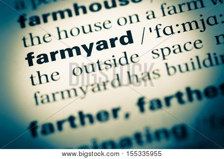 Close Up Of Old English Dictionary Page With Word Farmyard