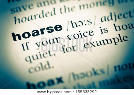 Close Up Of Old English Dictionary Page With Word Hoarse