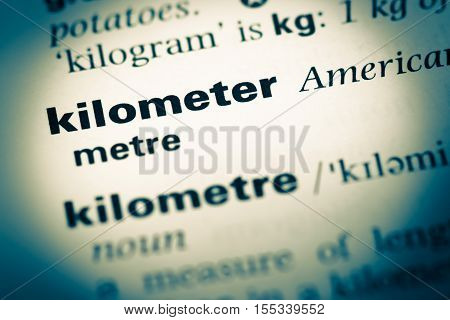 Close Up Of Old English Dictionary Page With Word Kilometer
