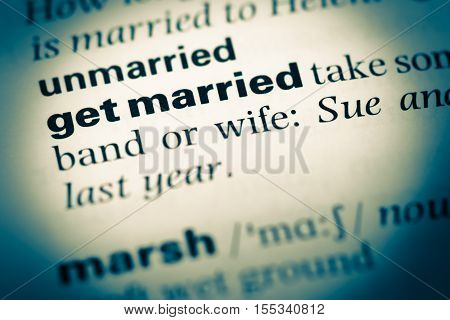 Close Up Of Old English Dictionary Page With Word Get Married