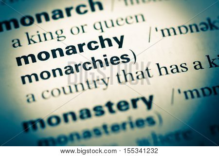 Close Up Of Old English Dictionary Page With Word Monarchy