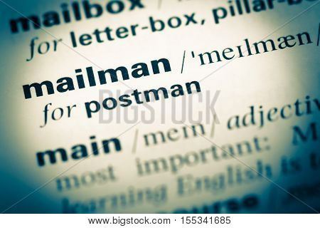 Close Up Of Old English Dictionary Page With Word Mailman