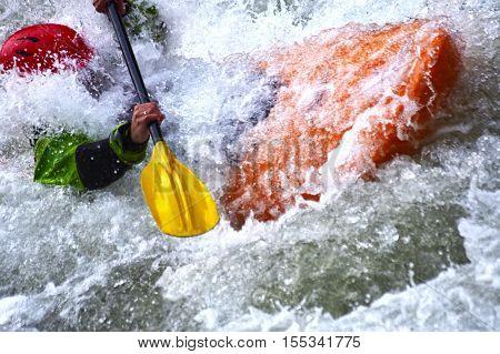 Extreme river kayaking as fun sport splashing the whitewater