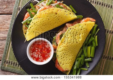 Vietnamese Banh Xeo Crepes With Pork, Shrimp And Bean Sprouts And A Sauce Closeup. Horizontal Top Vi