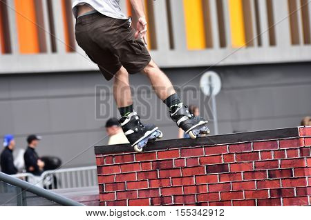 Rollerblade jump trick at a city background. Skate as extreme and fun sport.