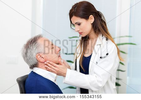 Doctor checking the lymph nodes size of her patient