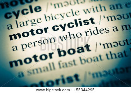 Close Up Of Old English Dictionary Page With Word Motor Cyclist