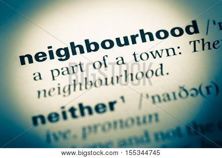 Close Up Of Old English Dictionary Page With Word Neighbourhood