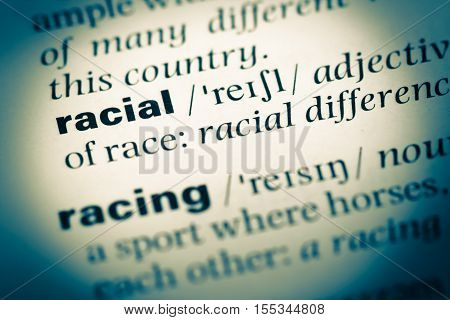 Close Up Of Old English Dictionary Page With Word Racial