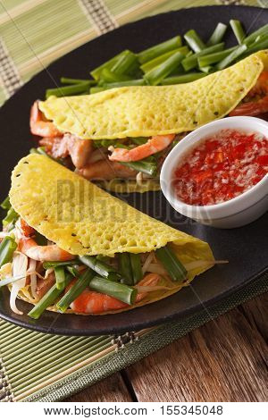 Vietnamese Banh Xeo Crepes With Pork, Shrimp And Bean Sprouts And A Sauce Closeup. Vertical