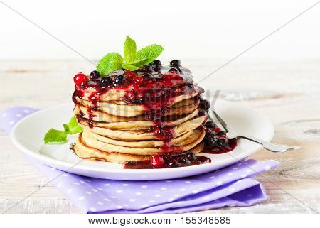 Pancakes. Stack of pancakes topped with berry jam. Breakfast.