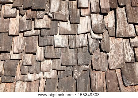 Old distressed weathered brown wood tile background