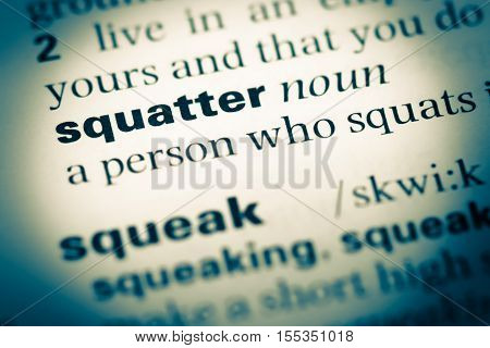 Close Up Of Old English Dictionary Page With Word Squatter