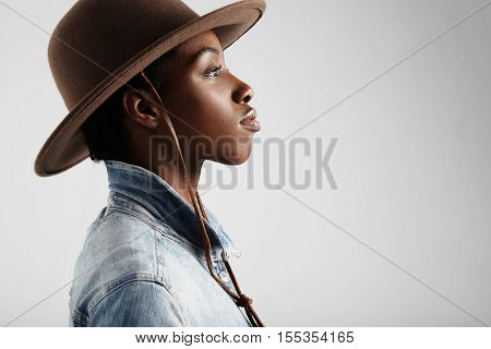 black woman's profile portrait wears cowboy hat