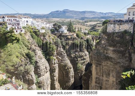 View from the new Bridge over Guadalevin River in Ronda Malaga Spain. Popular landmark in the evening