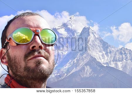 Alpinist looking at the summit, mountain background