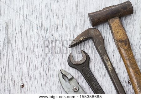 Hammer nail puller wrench and plyer carpenter's tools
