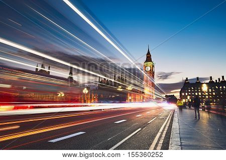 Light trails on the Westminster bridge after sunset. Big Ben and House of Parliament in London The United Kingdom of Great Britain and Northern Ireland