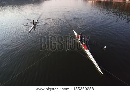 Canoe Kayak Scull rowing team training. Aerial view,