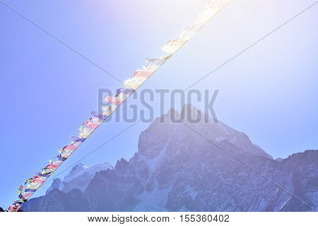 Tibetan prayer flags at high Himalaya mountain range
