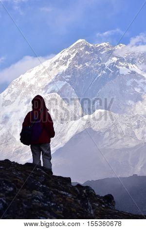 Standing at mount Nuptse. Trekker looking at mount Nuptse