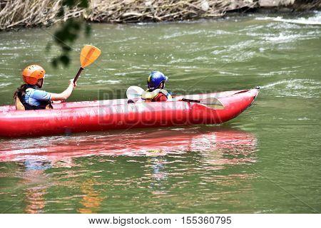 Kid in the kayak, kayaking as fun sport