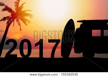 silhouette vintage car in the beach with a surfboard on the roof.text for Background year 2017
