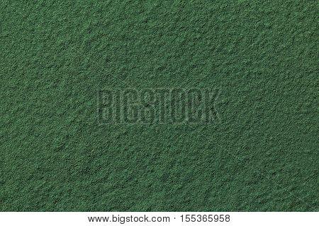 Green background texture of spirulina algae powder