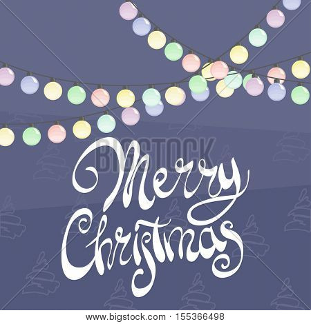 Festive garland with the words Merry Christmas on a blue background