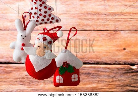 Christmas Holiday Background With Santa Claus, Bunny, House, Spruce, Decorations And Toys