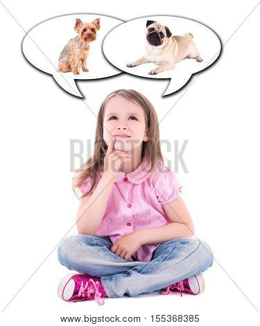 cute thoughtful little girl sitting and dreaming about dog isolated on white background